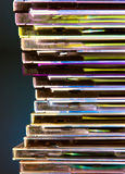 Looking trough the data rainbow. Light refractions on a cd-cases stack Stock Photo