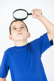 Looking trough magnifier Royalty Free Stock Photo