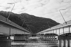Looking in between two bridges black and white photo Stock Photo