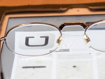 Looking at Uber. Glasses on a tablet computer framing the Uber logo for your concepts stock images