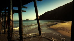 Looking under Pier Vintage style. A low angle shot from under a pier. HD 1080 stock footage