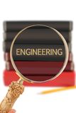 Looking in on University education - Engineering. Magnifying glass or loop looking on an educational university subject - Engineering stock images