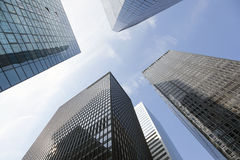 Looking uop to modern glass and steel office buildings in lower Royalty Free Stock Photos