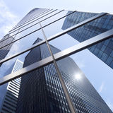 Looking uop to modern glass and steel office buildings in lower Royalty Free Stock Photo