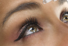 Looking up. Close up on the eyes of a young woman Stock Photography
