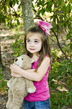 Looking Up. Little girl looking up with her eyes holding her favorite teddy bear and best friend Royalty Free Stock Photos