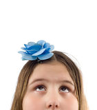 Looking Up. Closeup view of a young girl's head with her eyes looking up at blank copyspace above her, isolated against a white background Royalty Free Stock Photography