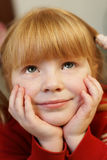 Looking up. Redhead little girl looking up in sweet dreams Royalty Free Stock Photo