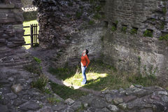 Looking Up. Woman Looking Up At Castle Ruins Stock Image