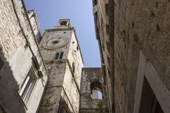 Looking up at the ancient tower clock of Split city in Croatia. SPLIT, CROATIA - AUGUSt 11 2017: Looking up at the ancient tower clock of Split city in Croatia stock image