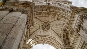 Looking up at Arc Augusta, Arc de Triomphe, Lisbon, Portugal. Lisbon is continental Europe`s westernmost capital city and the onl. Looking up at Arc Augusta, Arc Stock Photos
