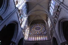 Looking up at arched ceilings and stained glass arches in French cathedral in Saint-Malo France, Saint VIncent of Saint-Malo royalty free stock photos