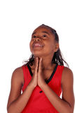 Looking up as she prays. Young African American looking up as she prays Stock Photos