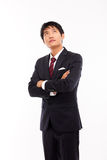 Looking up Asian business man Royalty Free Stock Photography