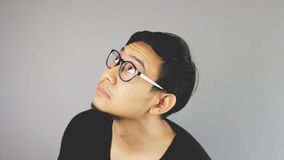 Looking up. An asian man with black t-shirt stock photography