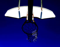 Looking up at a basketball hoop. Underneath a basketball hoop outdoor Stock Photography