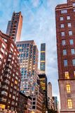 New York City, Madison Avenue - November 1, 2017:  Looking up at classic architecture and buildings on Madison Avenue at dusk Royalty Free Stock Photo