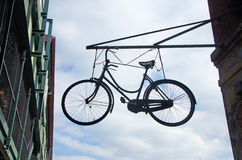 Looking up a bicycle hanging in New York City on September 14, 2014 Stock Images