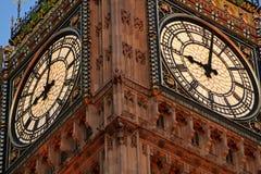 Looking up at big ben clockface. During the evening stock images