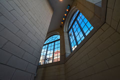Looking up. Big windows illuminate the walkway in a modern building Stock Photography