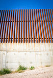 Looking up at border wall between united states and mexico.  royalty free stock image