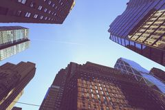 Looking up at buildings in Manhattan Stock Photo