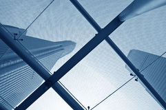Looking up at business buildings. Through a glass roof Stock Photography