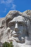 Mount Rushmore Close Up. Looking up at a carved likeness of Abraham Lincoln, one of four United States Presidents carved into granite at Mount Rushmore National royalty free stock image
