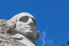 Mount Rushmore Close Up. Looking up at a carved likeness of George Washington, one of four United States Presidents carved into granite at Mount Rushmore stock photos