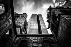Looking up at a cathedral and the John Hancock Building in Bosto Stock Images