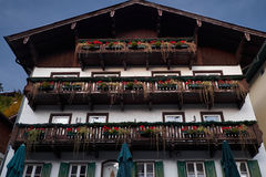 Looking up at chalet balconies with flowers in Alps. Mountains Stock Images