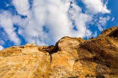 Looking up cliff at sky Royalty Free Stock Photo