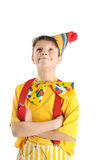 Looking up clown boy. Brightly dressed hamming clown boy is looking up Royalty Free Stock Image