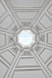 Looking up into a domed roof with a skylight Royalty Free Stock Photography