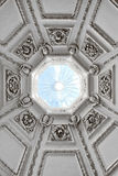 Looking up into a domed roof with a skylight Stock Images