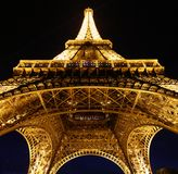 Looking up at Eiffel at night royalty free stock photography