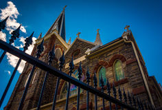 Looking up at a fence and  St. Peter's Roman Catholic Church, in Stock Photography