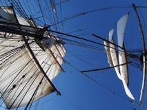 Looking up at the full sails of a tallship at sea Stock Photo