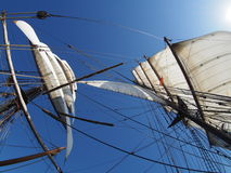 Looking up at the full sails of a traditional tallship at sea Royalty Free Stock Images