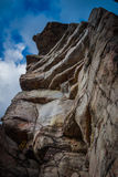 Looking up at giant granite outcropping foreground along hiking trail at Sam's Point Preserve Stock Image