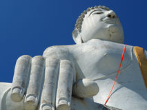 Looking up giant statue of Buddha Royalty Free Stock Image