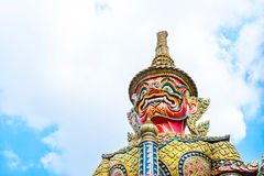 Looking up at giant statue at Grand palace, Temple of the Emeral Royalty Free Stock Image