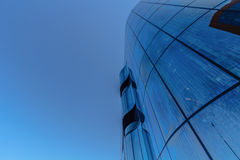 Looking up at glass business building Royalty Free Stock Photo