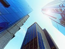 Looking Up glass skyscrapers. Daylight Royalty Free Stock Image