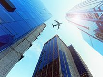 Looking Up glass skyscrapers silhouette airplane flying. Looking Up glass skyscrapers silhouette of airplane flying Royalty Free Stock Photos