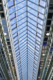 Glass ceiling. Looking up at the glass and steel ceiling of a huge exhibition hall Stock Photo