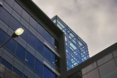 Looking up at gloomy office buildings royalty free stock images