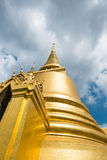 Looking up at gold pagoda Temple of the Emerald Buddha,Grand pal Royalty Free Stock Photo