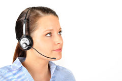 Looking up with a headset. Dark haired woman wearing a headset while looking up, headset nicely lit and in focus as wel as her eyes Stock Photography