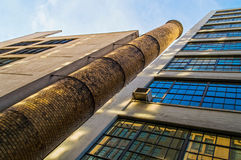 Looking Up High Line. An old smoke stack and factory looking up along the High Line Park in New York City Royalty Free Stock Photography
